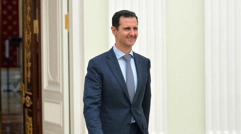 Bashar al-Assad smiling